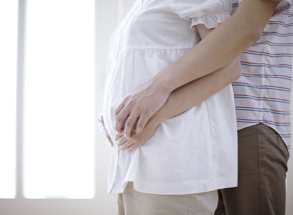 Hands on Pregnant Woman's Belly