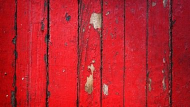 peeling-red-paint-on-old-barn