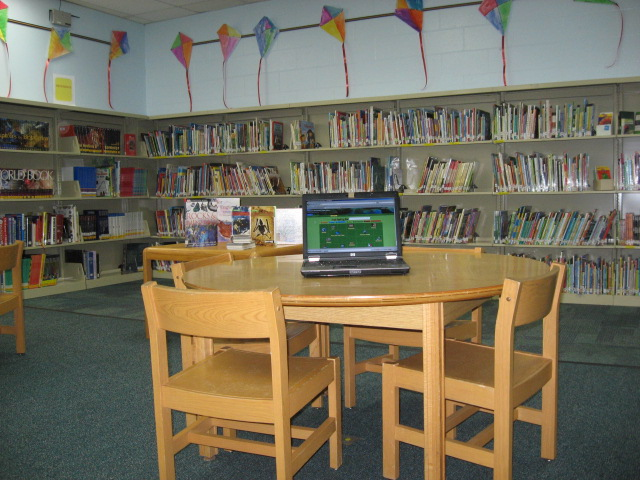 library-table-with-laptop